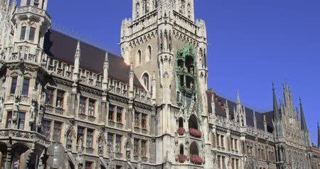 escarlate : The main square in the center of Munich, Germany. Detail of the historical town hall. Shoot on 4K RED Scarlet.