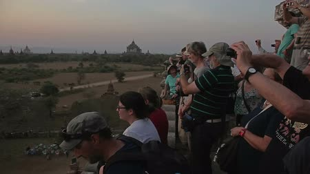 nyaung u : NZAUNG-U, MYANMAR - FEBRUARY 22: Tourist watching the sunset on the ancient pagoda in Bagan on February 22, 2012 in Nyaung-U, Myanmar.