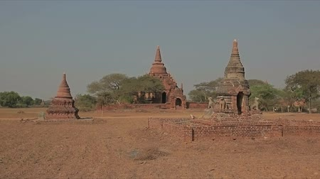 paya : Ancient stupa in the field in Old Bagan. Myanmar.