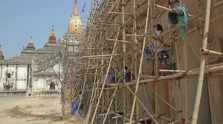 paya : BAGAN, MYANMAR - FEBRUARY 23: Restoration of ancient Ananda Temple with bamboo scaffolding on February 23, 2013 in Bagan, Myanmar. Built in 1105 AD during the reign of King Kyanzittha.