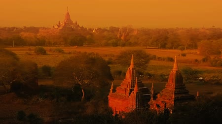 mianmar : Colorful sunset in Bagan, Myanmar. Hundreds of pagodas with Irrawaddy River in the distance.