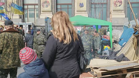 kijev : KIEV, UKRAINE - MARCH 22, 2014: Field kitchen for the military at Maidan square with lot of people visiting and passing by.