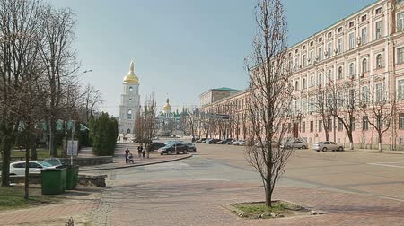catedral : KIEV, UKRAINE - MARCH 22, 2014: Wide shot of Saint Sophia Cathedral tower at Sofiiska square with The Khmelnytsky Monument.