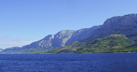 traverse : Biokovo mountain shot from sea side in summer morning.