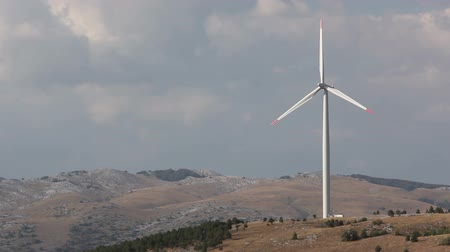 türbin : Wind turbine against sky with clouds. Mediterranean landscape. Stok Video
