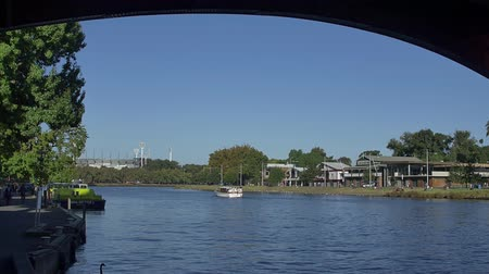 boathouse : MELBOURNE AUSTRALIA  MARCH 21 2015: View of the Boathouse arhitecture and the boat sailing from the Princes walk.