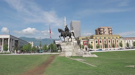 lem : TIRANA ALBANIA  MAY 26 2015 Handheld shot on Skanderbeg square with a view to the Skanderbeg monument and Ethem Bey Mosque.