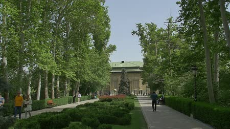 teheran : TEHRAN, IRAN - MAY 1, 2015:  Walkers walking from the park to the Green Palace Museum Sabz in a beautiful sunny day.