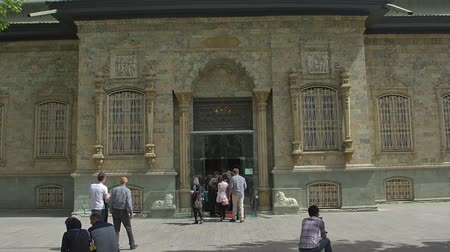 teheran : TEHRAN, IRAN - MAY 1, 2015: View of the Green Palace Museum Sabz entrance with visitors in the front, in a beautiful sunny day. Stock Footage