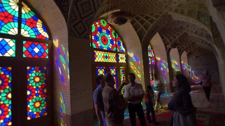 persie : SHIRAZ, IRAN - MAY 2, 2015: Visitors take a tour of the beautiful interior of the Nasir Al-Mulk Mosque or Pink Mosque a traditional mosque located in Goad-e-Araban place.