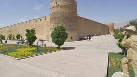 persie : SHIRAZ, IRAN - MAY 2, 2015: Photographer statue by Vakil Fortress of the old citadel Karmin Khan in the centre of the city. Dostupné videozáznamy