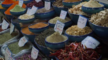 spices : SHIRAZ, IRAN - MAY 3, 2015: Exposed spices with prices in the store on the Vakil Bazaar, is located in the old city centre.