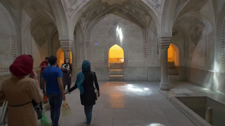 engravings : SHIRAZ, IRAN - MAY 2, 2015: Visitors take a tour of the room decoration inside the Arg of Karim Khan in the centre of the Shiraz city.