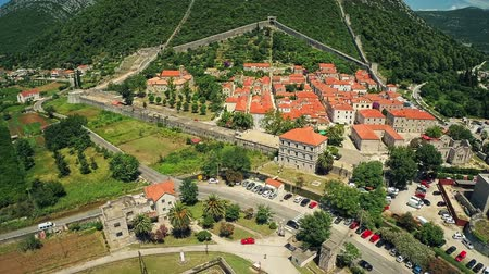 yeniden yapılanma : Copter aerial view of the old town Ston and its ancient walls in Dubrovnik county. Fortress Veliki Kastio in the front.