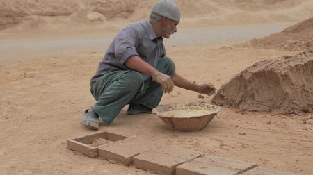 Clayman making bricks Stock Footage