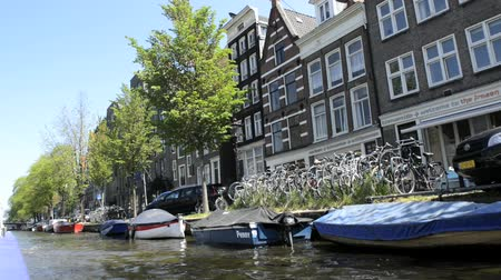 amsterodam : Amsterdam, Netherlands June 05, 2013: View to the canal and buildings from the sightseeing boat in Amsterdam, Netherlands.