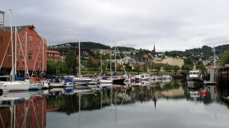 trondheim : Trondheim, Norway June 27, 2013: View to the city and boats tied at the harbor in Trondheim, Norway. Stock Footage