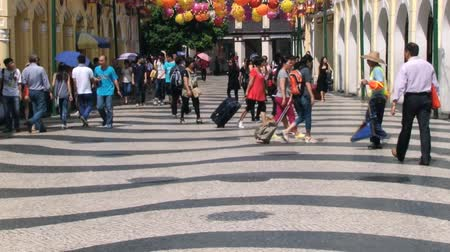 desenli : Macau, China, September 10, 2013 - People walk by the Senate square (Largo Senado) in of Macau, China.