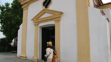 portugese : Macau, China, September 11, 2013 - People enter to the chapel of Our Lady of Guia in the Guia fortress in Macau, China. The chapel was built around 1622. Stock Footage