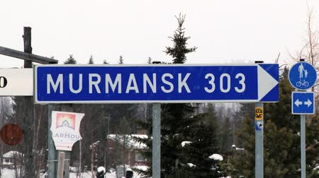 saariselka : Ivalo, Finland - February 16, 2013: View to the blue traffic sign with information about distance to Murmansk in Ivalo, Finland.IVALO, FINLAND - FEBRUARY 16, 2013: View to the blue traffic sign with information about distance to Murmansk in Ivalo, Finland Stock Footage