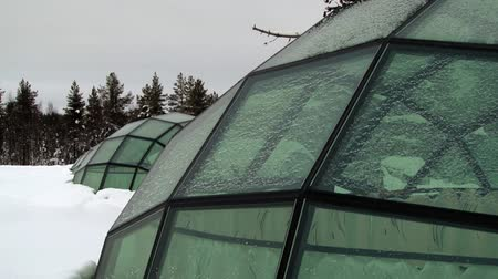 igloo : Saariselka, Finland - February 18, 2013: Exterior of the original hotel rooms built like glass igloos in Saariselka, Finland. Stock Footage