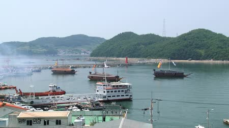 tongyeong : Tongyeong, Korea - August 17, 2013: View to the harbor with replicas of the Turtle ships in Tongyeong, Korea.