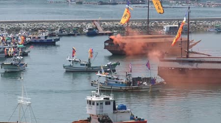 tongyeong : Tongyeong, Korea - August 17, 2013: View to the harbor with replicas of the Turtle warships during Hansan festival in Tongyeong, Korea.