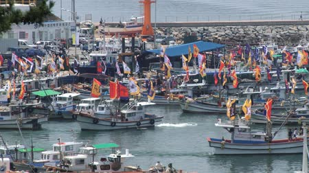 tongyeong : Tongyeong, Korea - August 17, 2013: Boats depart from harbor during Hansan festival in Tongyeong, Korea. Stock Footage