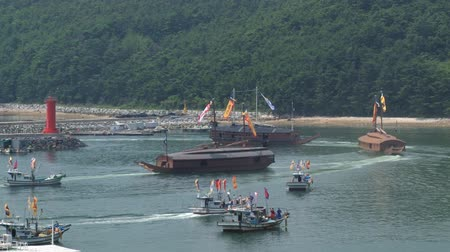 tongyeong : Tongyeong, Korea - August 17, 2013: Replicas of the Korean Turtle warships depart from harbor during Hansan festival in Tongyeong, Korea.