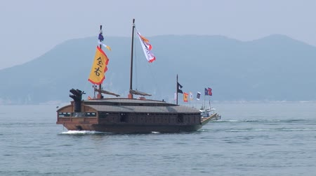 tongyeong : Tongyeong, Korea - August 17, 2013: Replica of the Korean Turtle warship sails by the sea Hansan festival in Tongyeong, Korea.