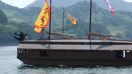 tongyeong : Tongyeong, Korea - August 17, 2013: Replicas of the Korean Turtle warship sail by the sea Hansan festival in Tongyeong, Korea.