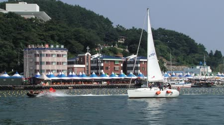 tongyeong : Tongyeong, Korea, August 17, 2013 - People sail yacht in the harbor of Tongyeong, Korea.