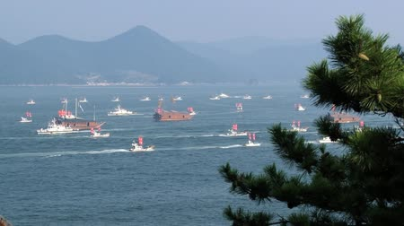 tongyeong : Tongyeong, Korea - August 17, 2013: View to the harbor with sailing replicas of the Turtle ships in Tongyeong, Korea.