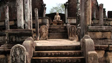 polonnaruwa : View to the Buddha statue in the ruins of a building in the ancient city of Polonnaruwa, Sri Lanka. Stock Footage
