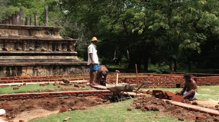 polonnaruwa : Polonnaruwa, Sri Lanka, October 19, 2013 - People do restoration work in the ancient city of Polonnaruwa, Sri Lanka.