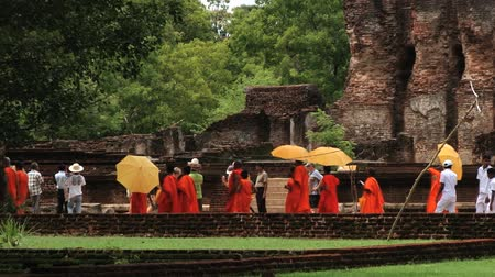 polonnaruwa : Polonnaruwa, Sri Lanka, October 19, 2013 - Monks pass by the ruins of the Royal Palace of King Parakramabahu in the ancient city of Polonnaruwa, Sri Lanka.