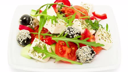 Fresh salad with feta cheese with herbs closeup intro motion slow