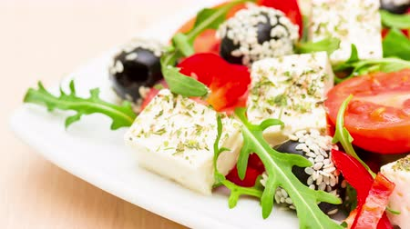 Fresh salad with feta cheese with herbs closeup motion slow 影像素材