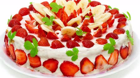 Beautiful decorated fruit cake, strawberry-banana paradise