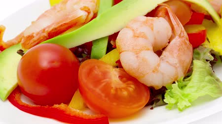 Healthy salad of shrimp, mixed greens and tomatoes 影像素材