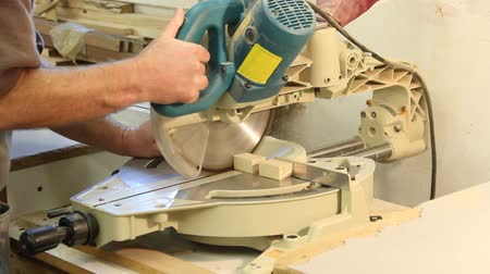 cabinetry : sliding miter saw cutting a board