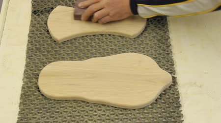 carpintaria :  woodworker finish sanding boards by hand