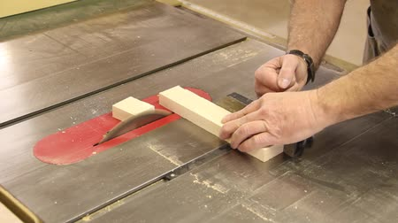 miter saw : cross cutting on a table saw Stock Footage
