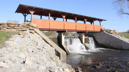 Wooden covered bridge over a dam Stok Video