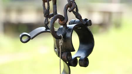 sürgün : Old black iron shackles. Ancient hammered fetters. Iron forged gyves