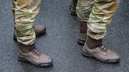 footgear : Feet of soldiers. Soldiers in military uniform. Servicemen at the military parade