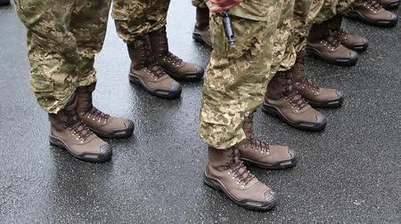 harcias : Soldiers in military uniform. Feet of soldiers. Servicemen at the military parade