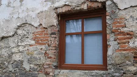 dişli : Old building with new window with venetian blind. Dilapidated brick wall of house Stok Video