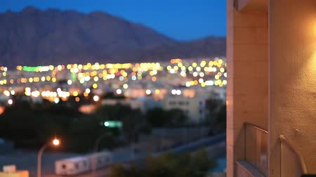 aqaba : View on evening Aqaba city in Jordan from hotel balcony. City in defocusing Stock Footage