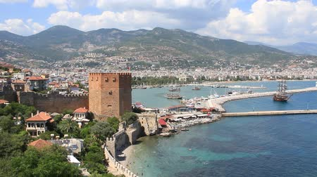seljuk : Kizil Kule (Red Tower) - main tourist attraction in the Turkish city of Alanya. Building is considered to be the symbol of the city and is even used on the citys flag. The large popular resort center of Alanya lies at the end of a rocky promontory which  Stock Footage
